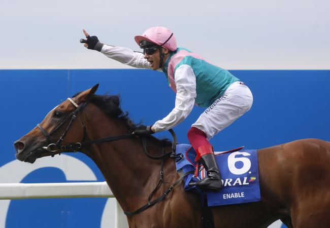 Frankie Dettori and Enable win The Coral-Eclipse Race run during Coral-Eclipse Day of the Coral Summer Festival at Sandown Park Racecourse, Esher..