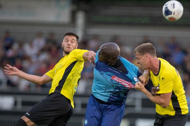 Wycombe Wanderers striker Adebayo Akinfenwa battles against two Maidenhead United (yellow) opponents during the 0-0 draw in a pre-season friendly match at York Road. PHOTOS: Andy Rowland.