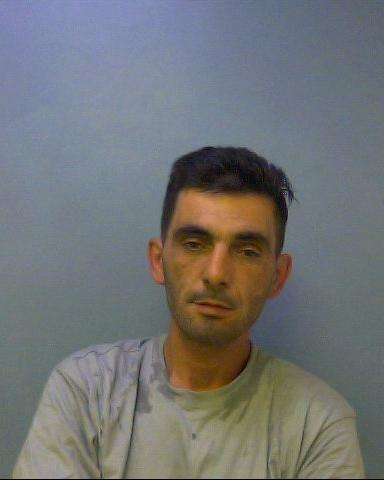 Armed burglar who threatened witness gets four years in prison