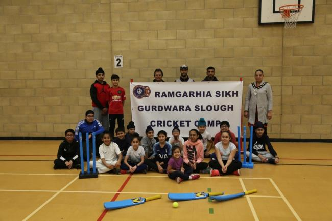 The Mayor of Slough, Councillor Avtar Kaur Cheema (back row and far right) opened the new youth indoor cricket training at Langley Grammar School.