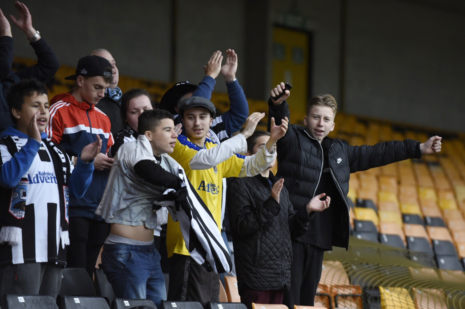 Young Maidenhead United fans cheer on their side during the 1-1 draw at Port Vale on Saturday.