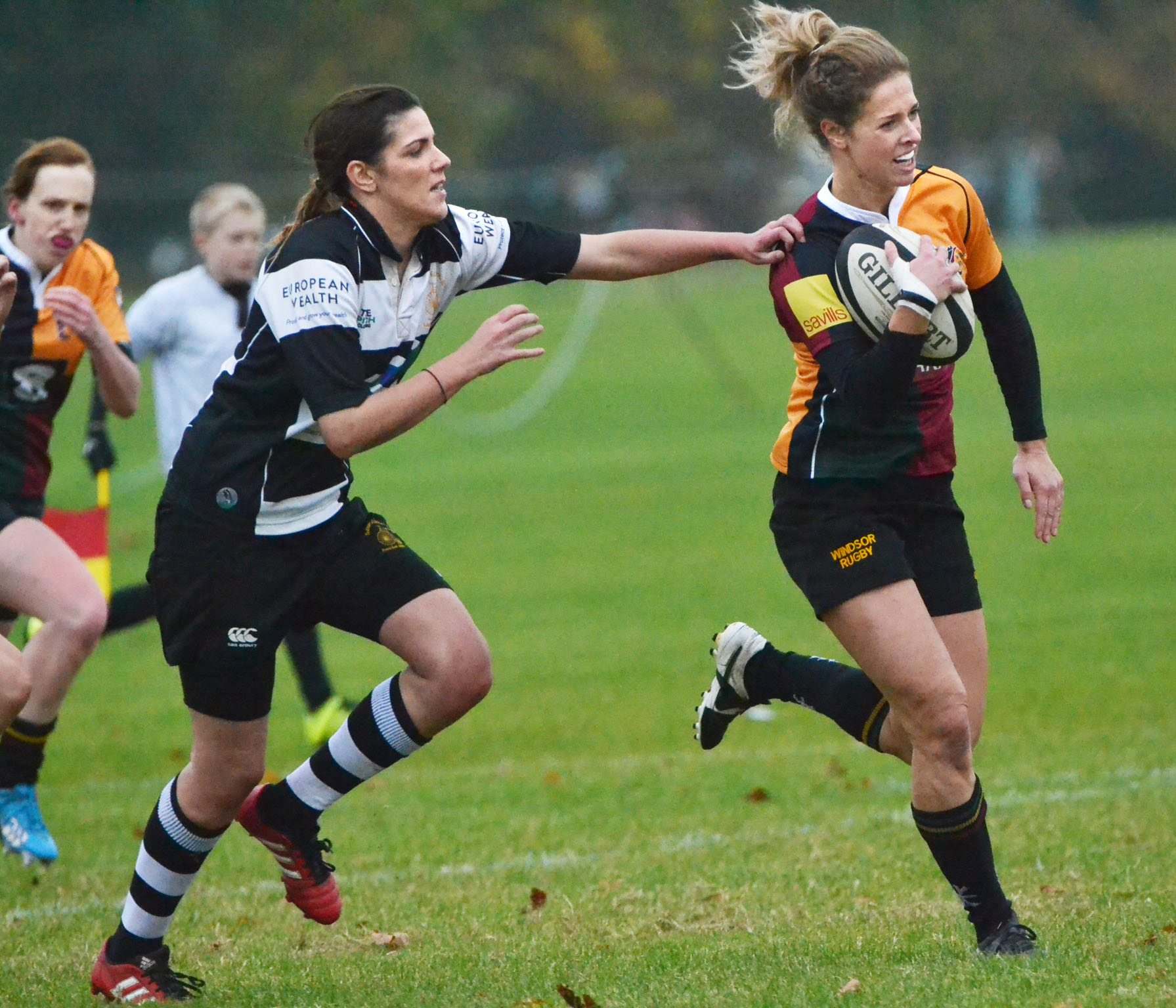Rachel Humphries (ball in hand) scored a try but Windsor Dames were beaten 27-14 at Newbury on Sunday.