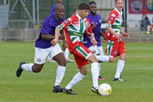 Windsor (red) midfielder Taufee Skandari carries the ball forward in the 1-0 win against Camberley Town on Saturday.