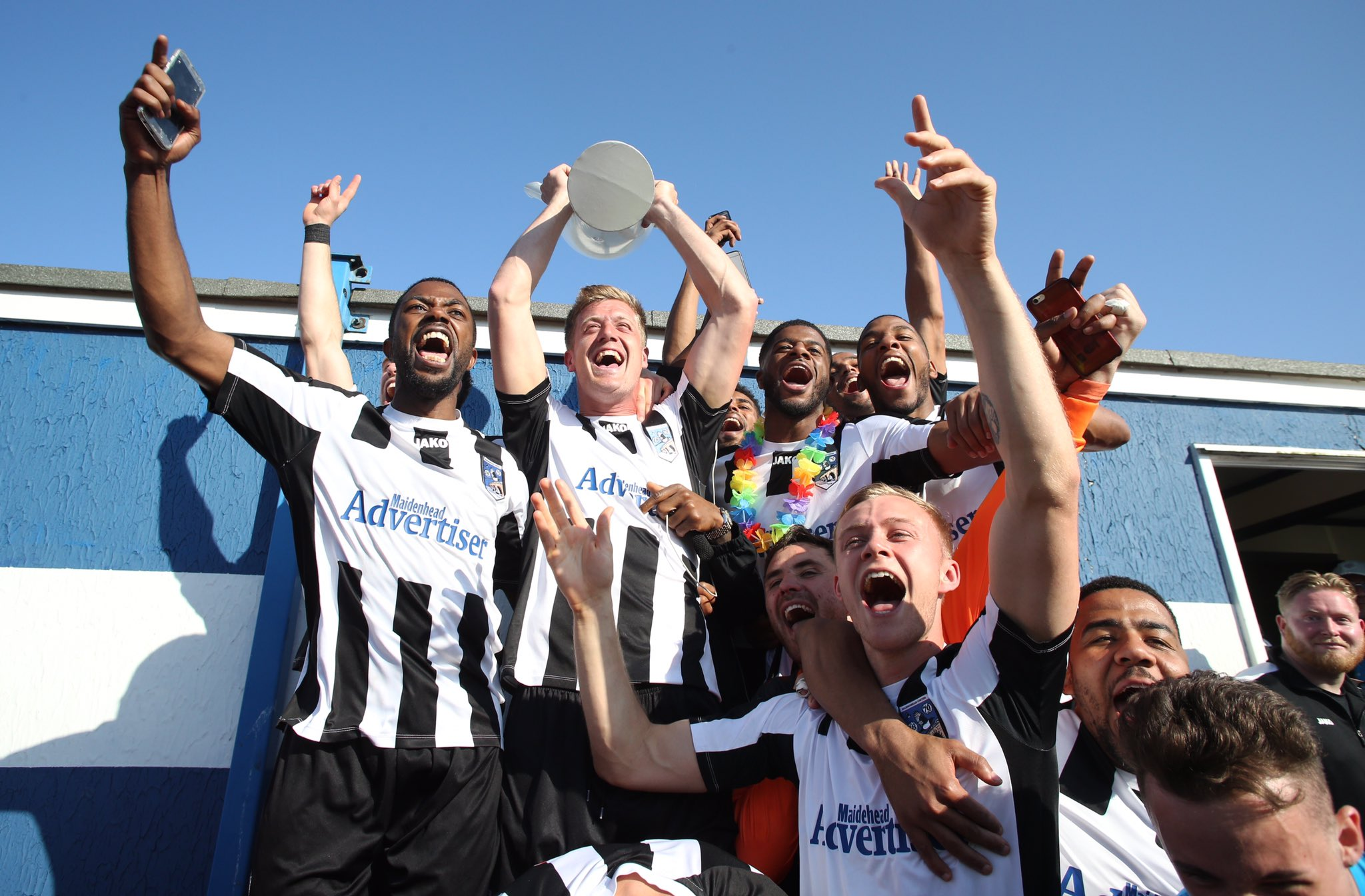 Maidenhead United celebrate winning the National League South title after a 3-0 win at Margate on Saturday. The Magpies top the division with 98 points, two clear of Ebbsfleet United in second place