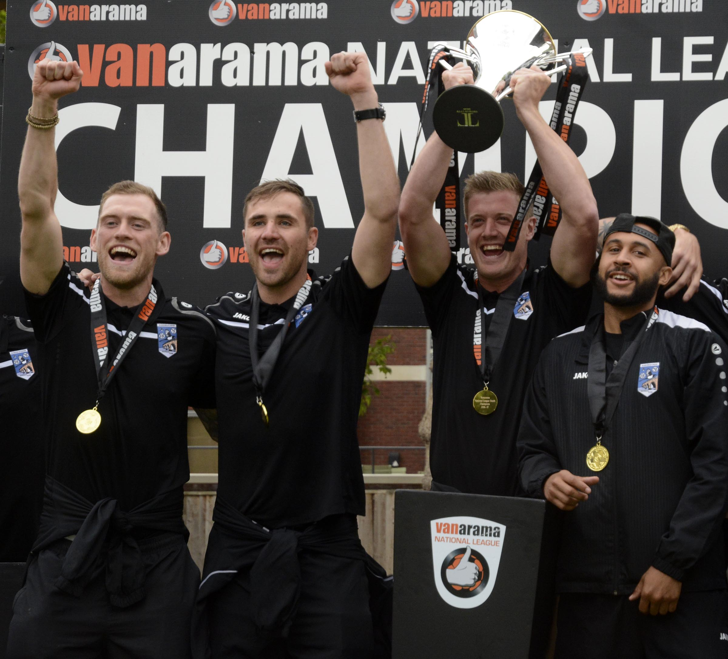 Maidenhead United players lift the National League South trophy this Saturday.