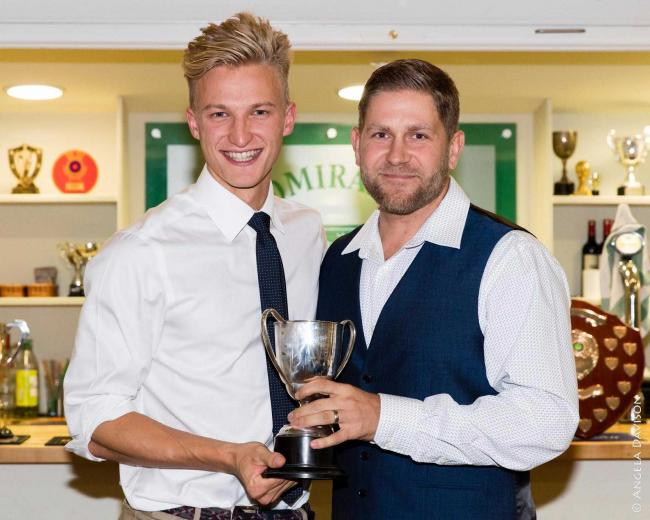 Andy Rishton collects the Most Improved Player award from coach Tom Lambert    Picture by Angela Davison