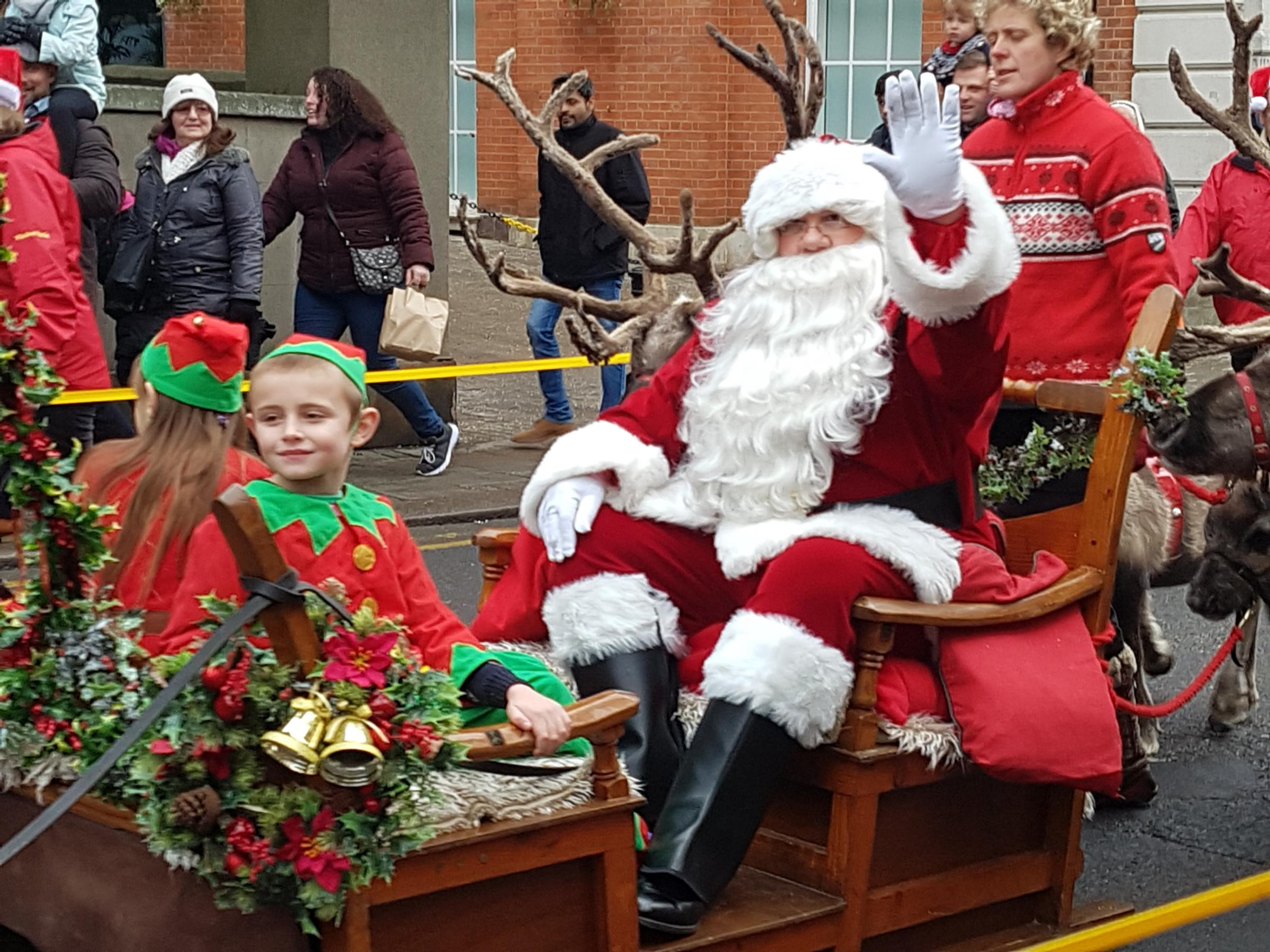 Crowds gather as Santa comes to Windsor town centre with his reindeer parade