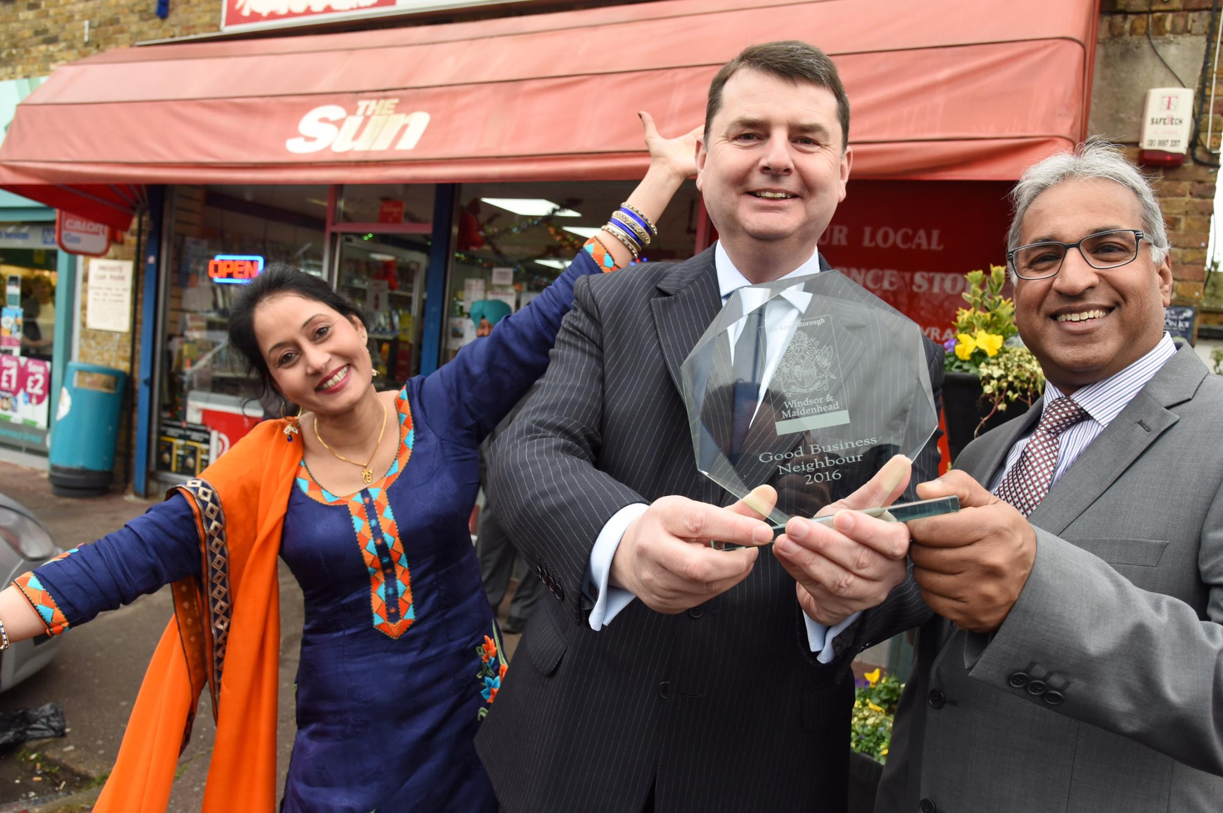 Ed Wilson with traders Daljit and Manjit Toor - past winners of the Good Business Neighbour award