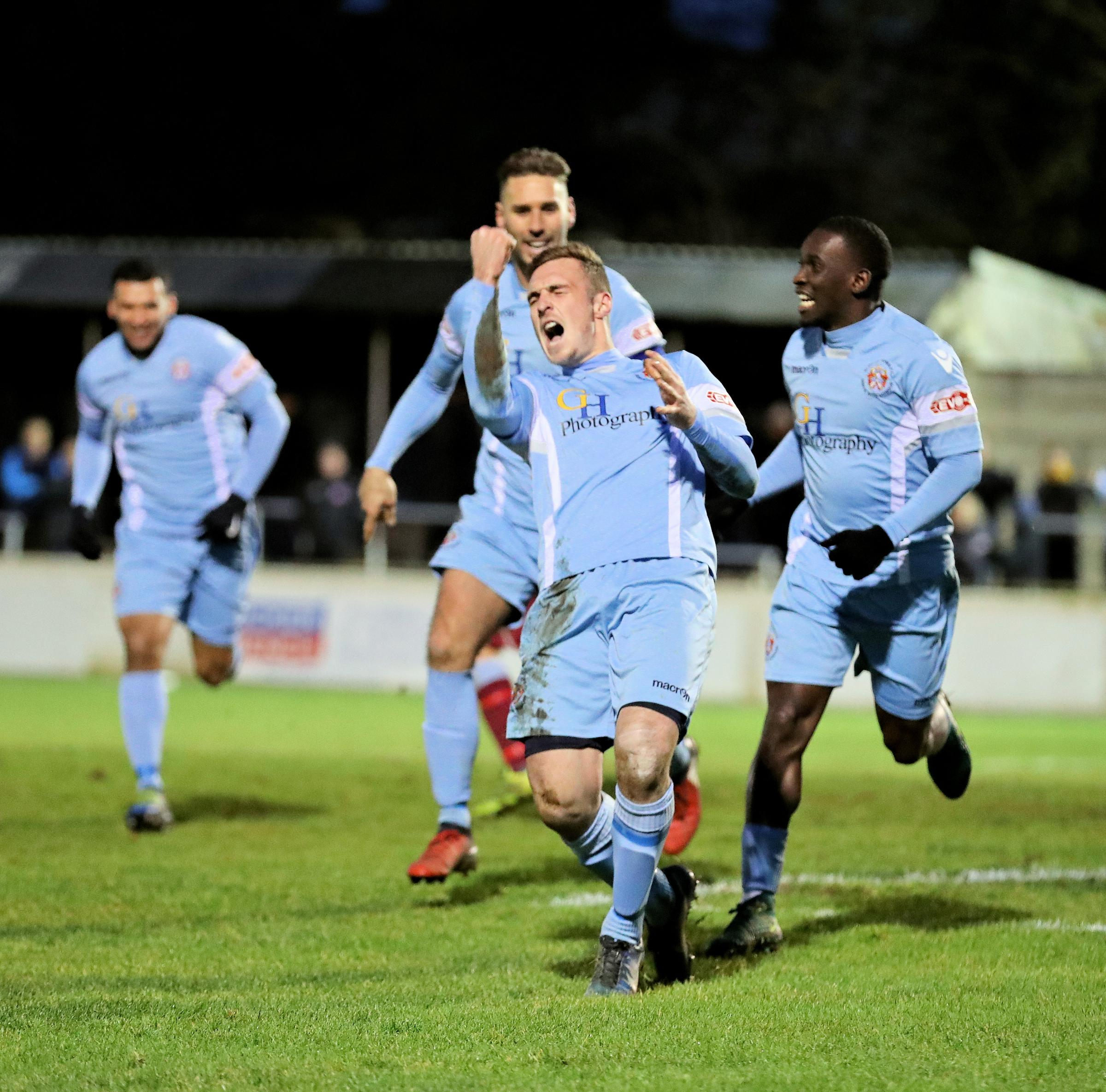 New Slough Town striker Ben Harris celebrates his goal on debut in the 1-1 draw at Chesham United on Monday. PHOTOS: Gary House Photography.
