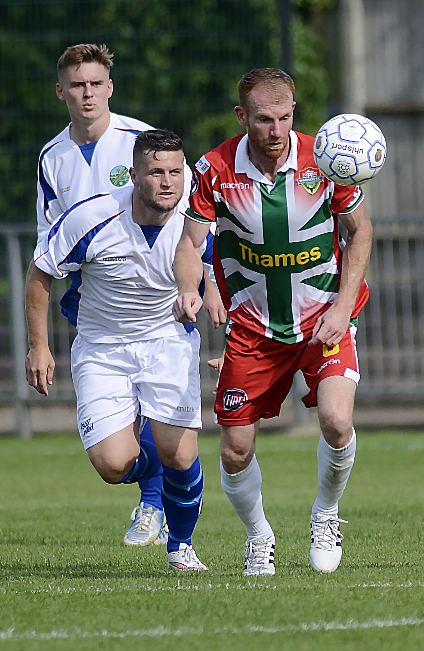 "Windsor midfielder Paul Coyne (in red and green): ""I enjoyed it last season so we will see how the new one goes and if we can do any better in the cups and the league."