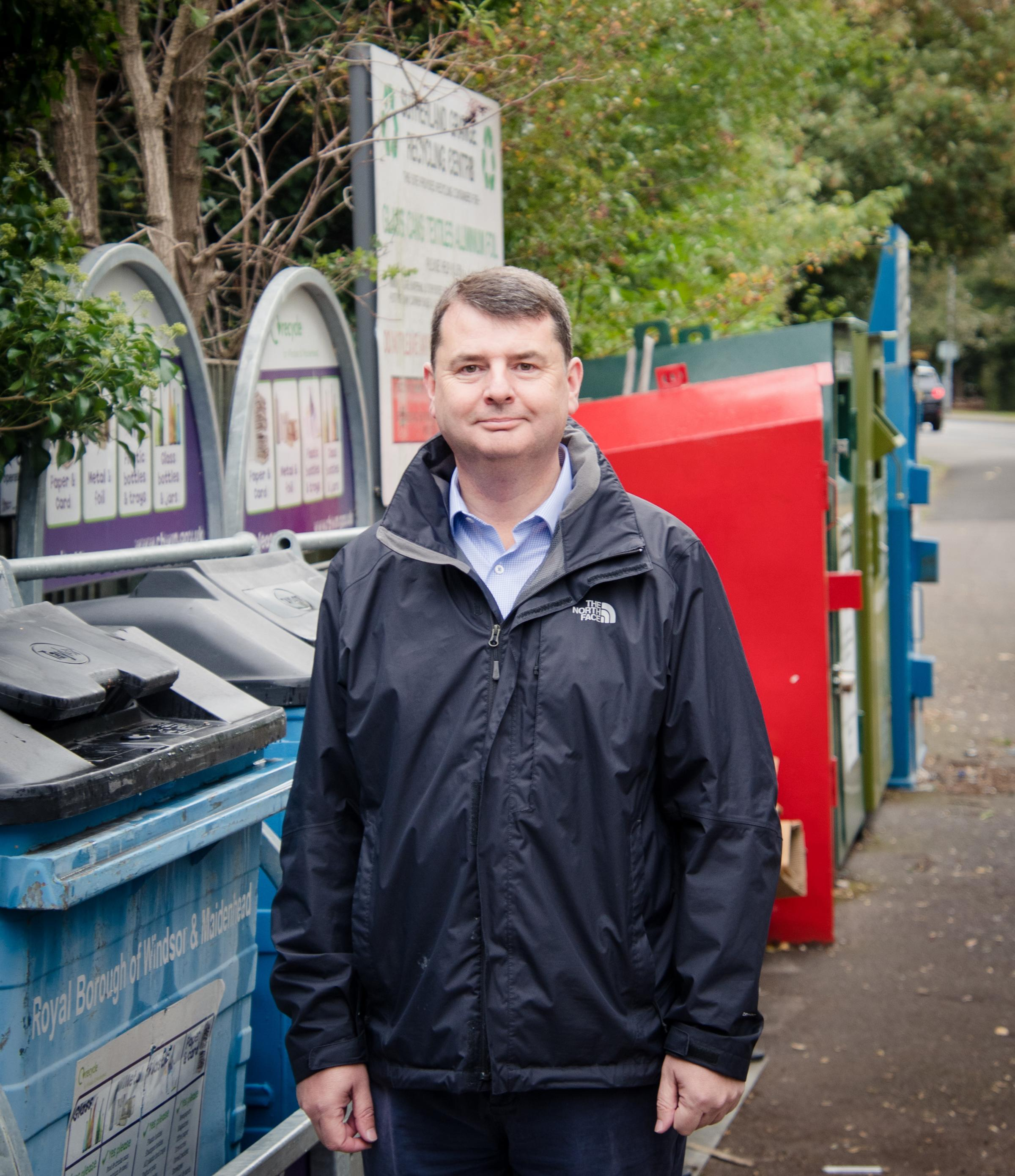Cllr Wilson mans the new bins