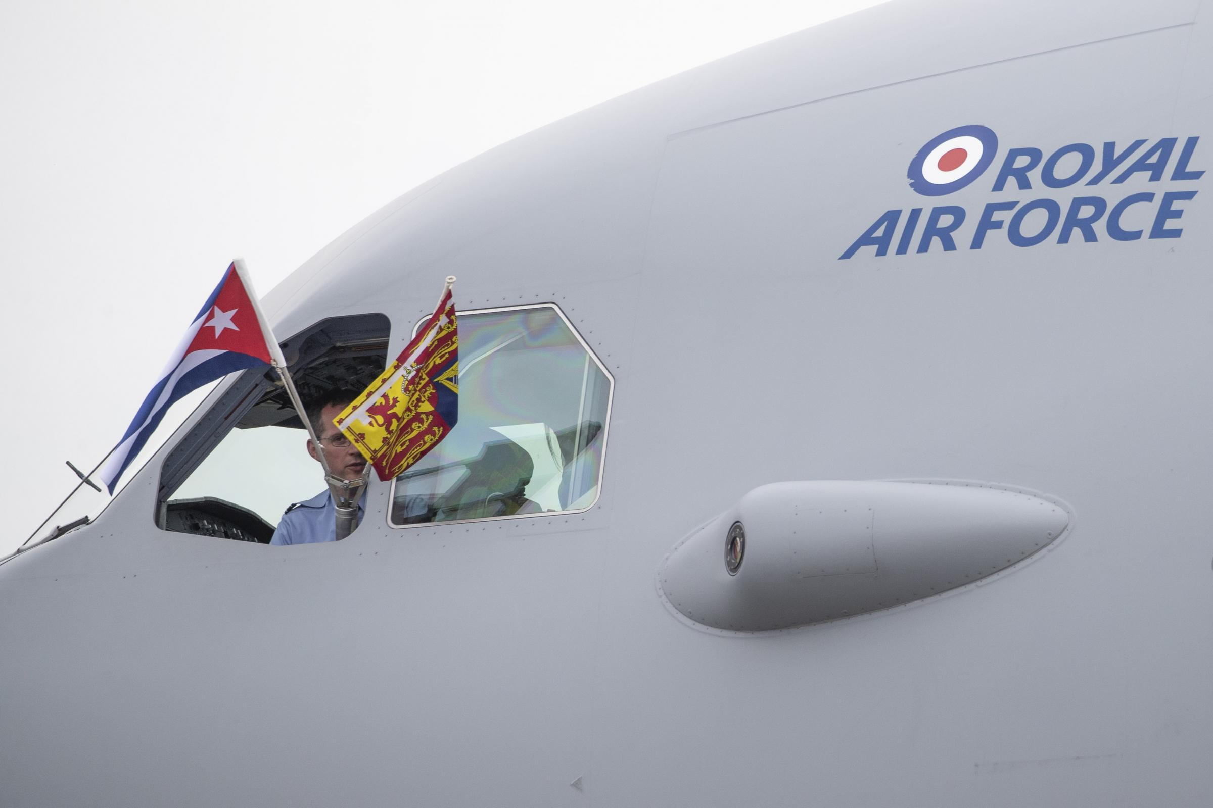 Flags are flown from the cockpit as the Prince of Wales and the Duchess of Cornwall arrive at Jose Marti International Airport in Havana, Cuba